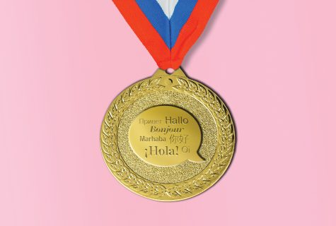 "A gold medal with ""hello"" written in different languages."