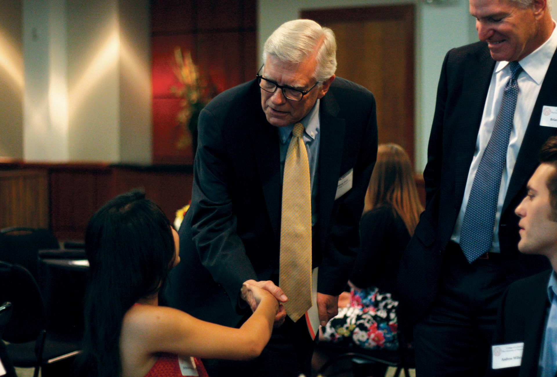 Randy Diehl greets Dean's Distinguished Graduate Rebekah Rodriguez and her family at a luncheon on May 15, 2014.
