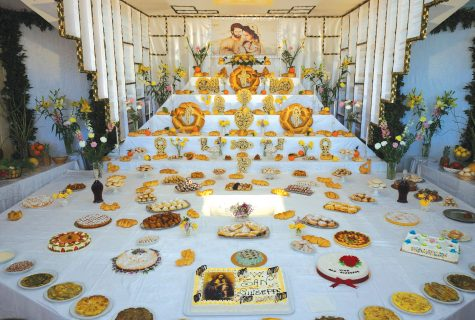 Large community altar with various desert cakes.
