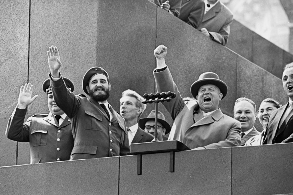 Fidel Castro and Soviet leader Nikita Khrushchev appear together on the rostrum of the Lenin Mausoleum during Castro's four-week official visit to Moscow in May 1963.