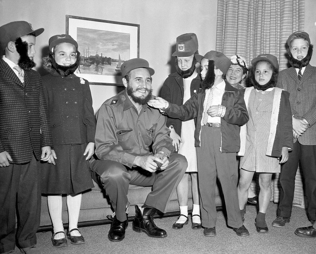 Fidel Castro clowns around with schoolchildren who were visiting him at his hotel in 1959.