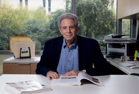 Portrait of Michael Stoff in his office located on the UT Austin campus.