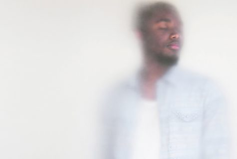 Artistic photo of a man with his eyes closed through a cloudy vellum.