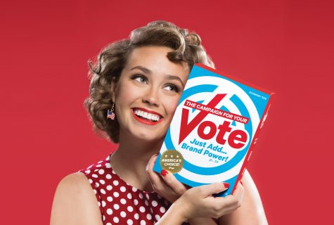 "A tongue-in-cheek photo of a smiling woman holding a brightly branded ""Vote"" box against a red background. The box reads, ""The Campaign for Your Vote: Just Add Brand Power!"" (America's Choice)."
