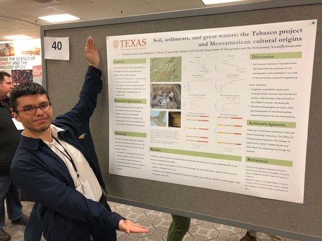 Fernando Casal stands next to his poster presentation.