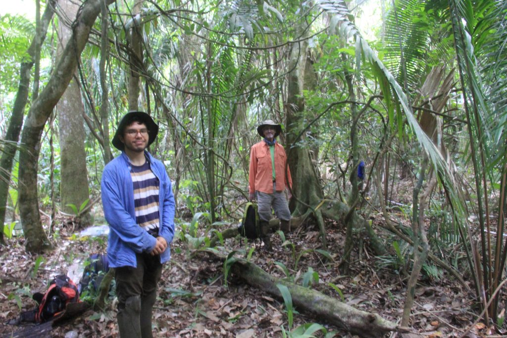 UT Austin researchers pose at research site in Belize.