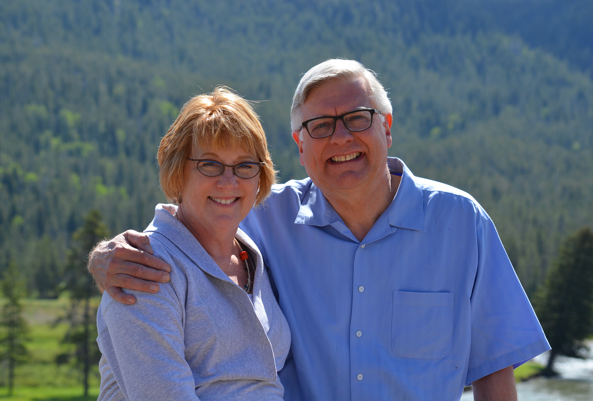 Mary and Randy Diehl with Yellowstone Park in background.