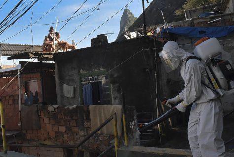 man disinfects street in Rio de Janeiro Brazil