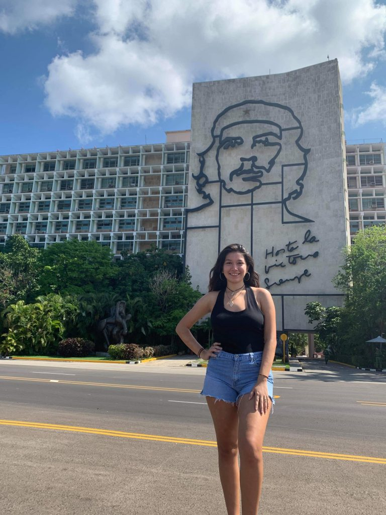 Rodriguez stands in front of a sculpture of Che Guevara in Plaza de la Revolución.
