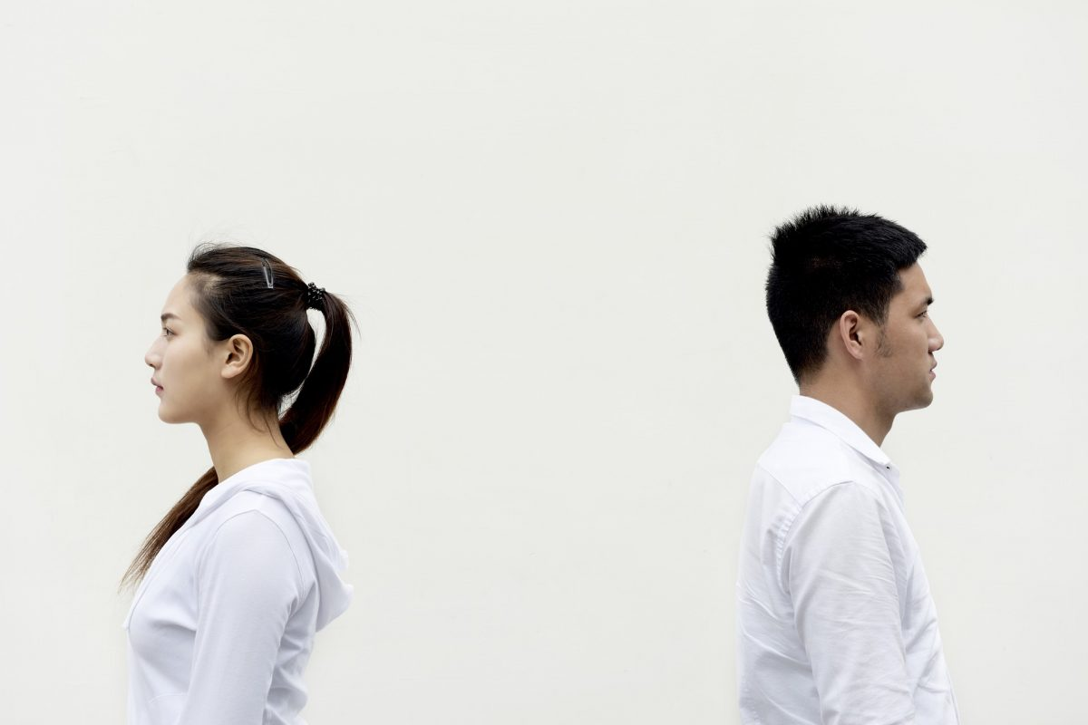 two people facing away from each other